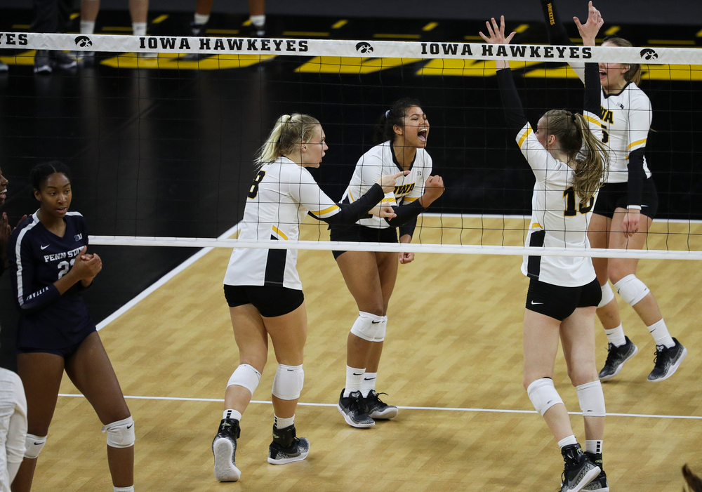Iowa Hawkeyes right side hitter Reghan Coyle (8) and Iowa Hawkeyes setter Brie Orr (7) celebrate after winning a point during a match against Penn State at Carver-Hawkeye Arena on November 3, 2018. (Tork Mason/hawkeyesports.com)