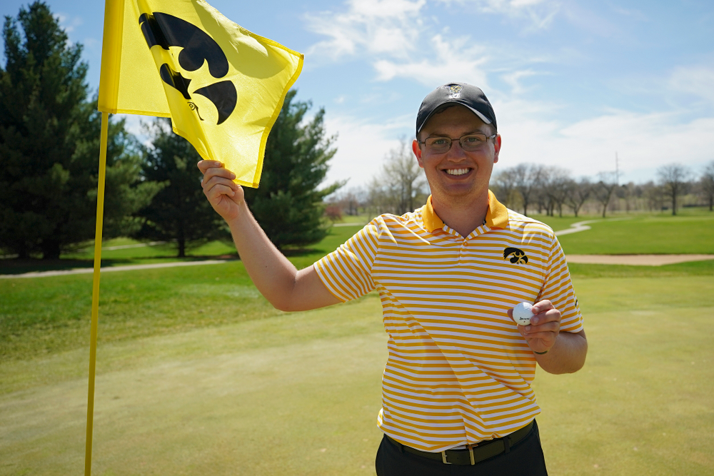 Iowa's Matthew Walker holds up the ball he used for a hole-in-one on the fourth hole during the third round of the Hawkeye Invitational at Finkbine Golf Course in Iowa City on Sunday, Apr. 21, 2019. (Stephen Mally/hawkeyesports.com)