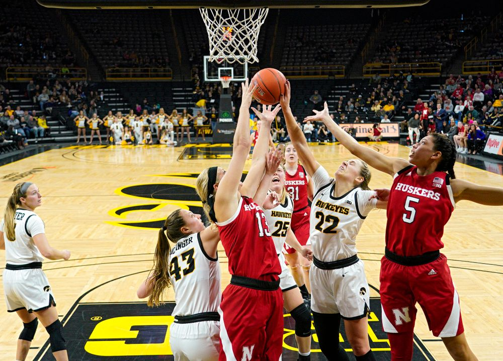 Iowa Hawkeyes forward Amanda Ollinger (43), forward Monika Czinano (25), and guard Kathleen Doyle (22) battle for a rebound during the second quarter of the game at Carver-Hawkeye Arena in Iowa City on Thursday, February 6, 2020. (Stephen Mally/hawkeyesports.com)