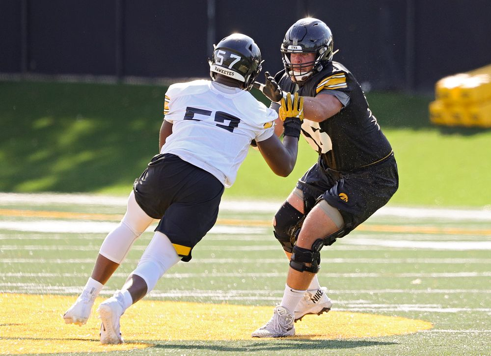 Iowa Hawkeyes defensive end Chauncey Golston (57) tries to get around offensive lineman Levi Paulsen (66) during Fall Camp Practice No. 13 at the Hansen Football Performance Center in Iowa City on Friday, Aug 16, 2019. (Stephen Mally/hawkeyesports.com)