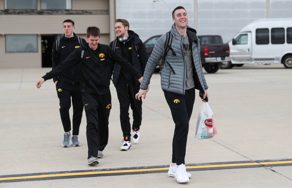 Iowa Hawkeyes guard Connor McCaffery (30) boards a flight to Columbus for the first and second rounds of the 2019 NCAA Men's Basketball Tournament Wednesday, March 20, 2019 at the Eastern Iowa Airport. (Brian Ray/hawkeyesports.com)