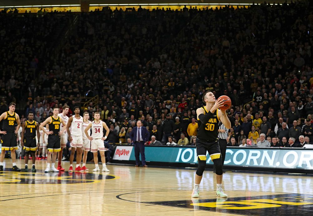 Iowa Hawkeyes guard Connor McCaffery (30) shoots a free throw after a technical foul was called on the Wisconsin Badgers during the second half of their game at Carver-Hawkeye Arena in Iowa City on Monday, January 27, 2020. (Stephen Mally/hawkeyesports.com)