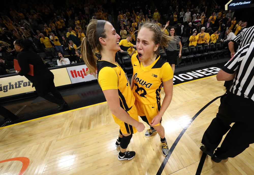 Iowa Hawkeyes guard Kathleen Doyle (22) celebrates with guard Makenzie Meyer (3) following their victory against the Maryland Terrapins Thursday, January 9, 2020 at Carver-Hawkeye Arena. (Brian Ray/hawkeyesports.com)