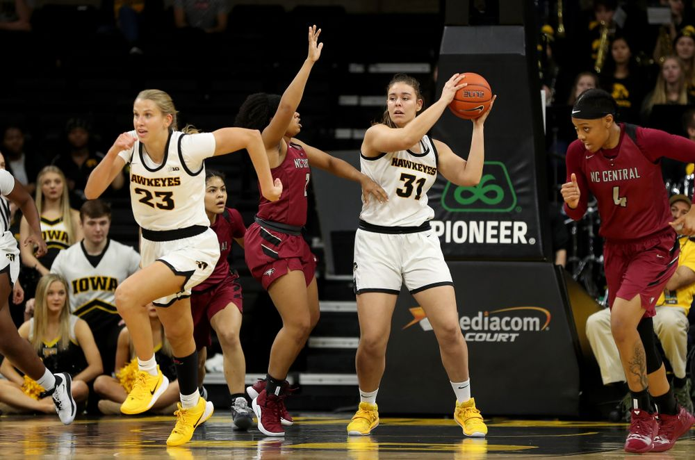 Iowa Hawkeyes forward/center Paula Vali?o Ramos (31) grabs a rebound against North Carolina Central Saturday, December 14, 2019 at Carver-Hawkeye Arena. (Brian Ray/hawkeyesports.com)