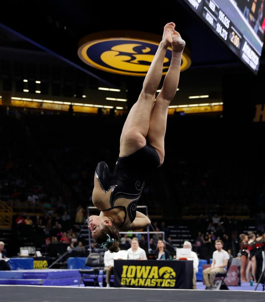 Iowa's Melissa Zurawski competes on the floor against the Nebraska Cornhuskers