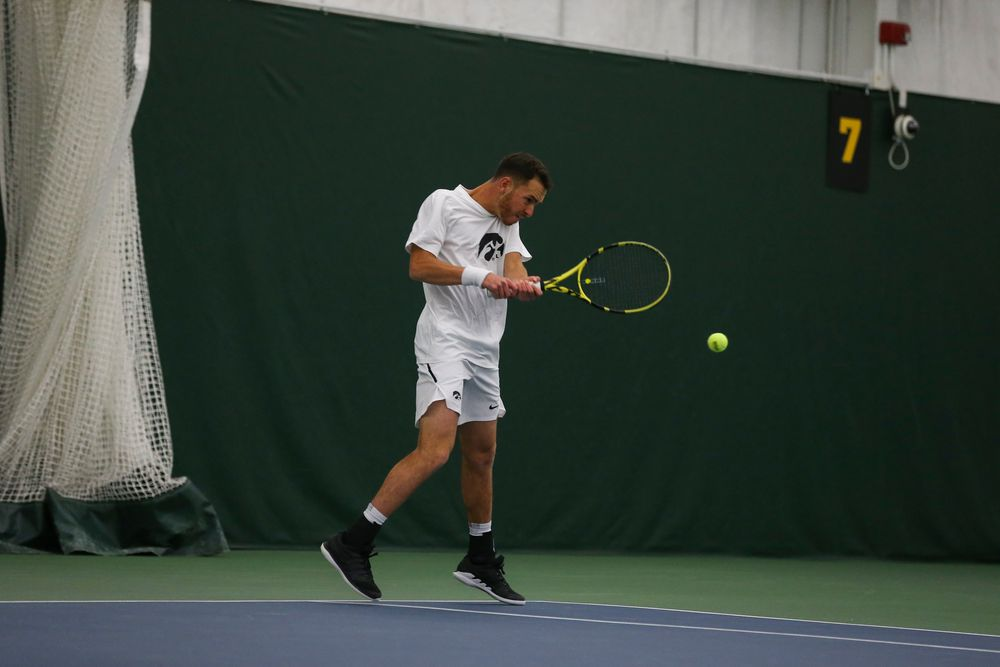 Iowa's Kareem Allaf hits a backhand during the Iowa men's tennis match vs Western Michigan on Saturday, January 18, 2020 at the Hawkeye Tennis and Recreation Complex. (Lily Smith/hawkeyesports.com)