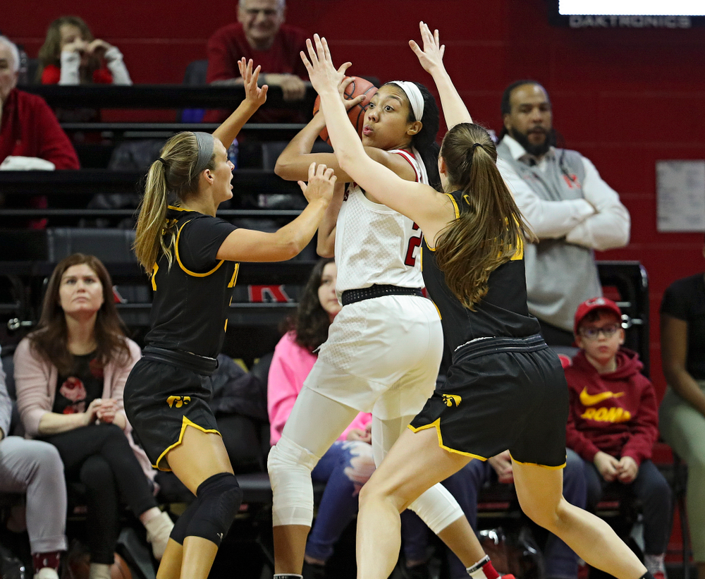 Iowa guard Makenzie Meyer (3) and forward Amanda Ollinger (43) defend during the fourth quarter of their game at the Rutgers Athletic Center in Piscataway, N.J. on Sunday, March 1, 2020. (Stephen Mally/hawkeyesports.com)