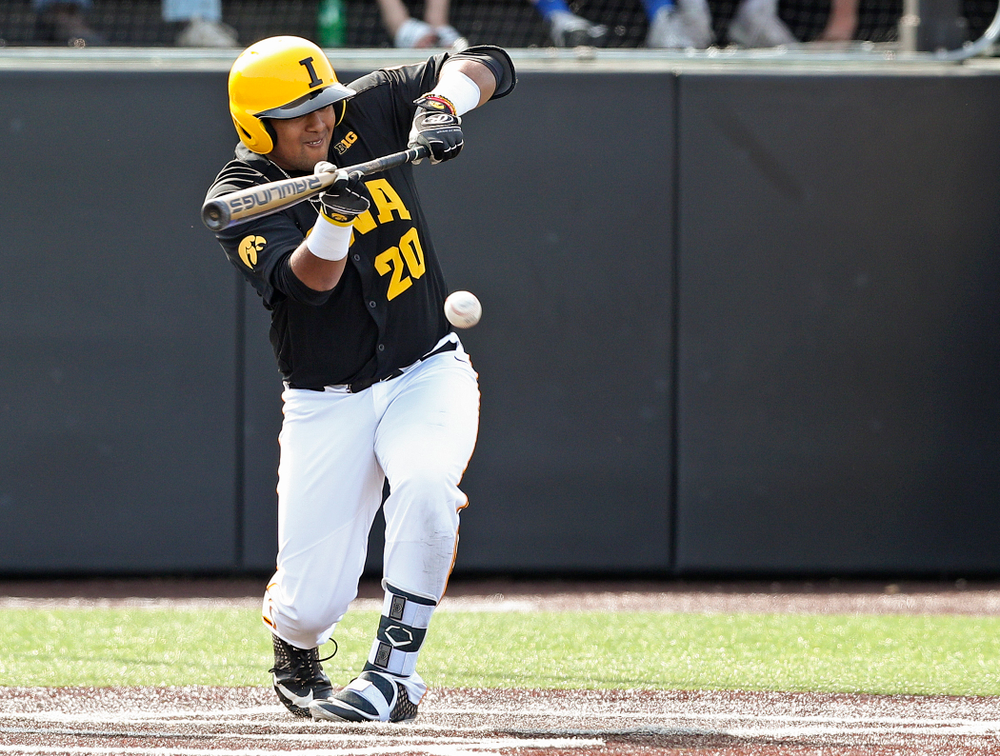Iowa Hawkeyes designated hitter Izaya Fullard (20) gets a bunt single during the sixth inning of their game against Rutgers at Duane Banks Field in Iowa City on Saturday, Apr. 6, 2019. (Stephen Mally/hawkeyesports.com)