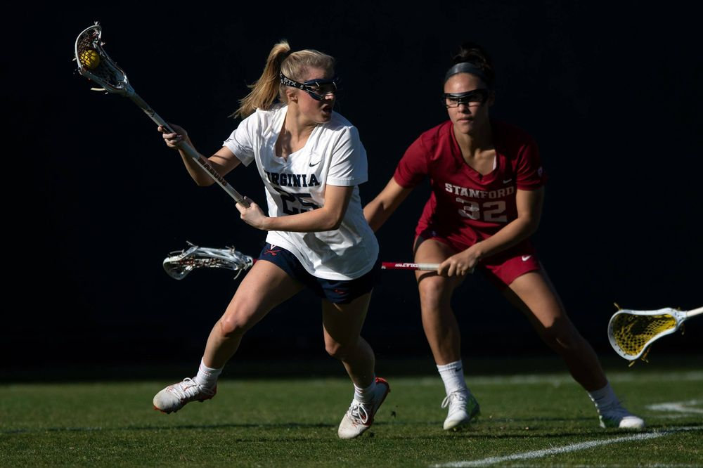 STANFORD, California - FEBRUARY 14:  Virginia Cavaliers midfield Courtlynne Caskin (25) is defended by Stanford Cardinal midfield Daniella McMahon (32) during the first half at Cagan Stadium on February 14, 2020 in Stanford, California. The Virginia Cavaliers defeated the Stanford Cardinal 12-11. (Photo by Jason O. Watson)