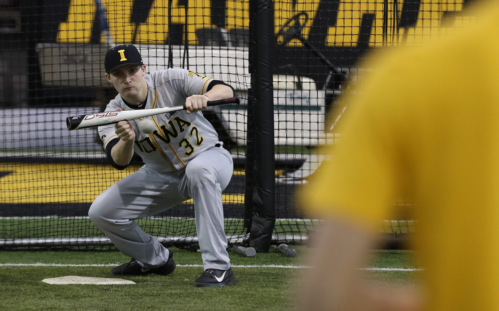 Iowa Hawkeyes catcher Brett McCleary (32) bunts the ball during practice Tuesday, February 5, 2019 in the Indoor Practice Facility. (Brian Ray/hawkeyesports.com)