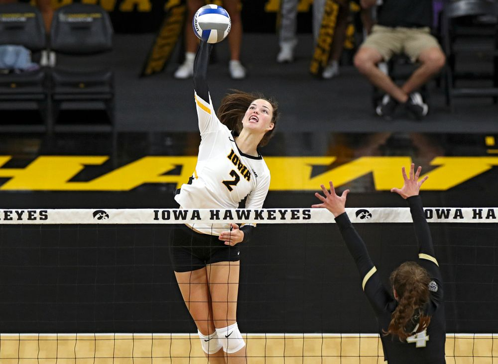 Iowa's Courtney Buzzerio (2) goes up for a kill during the second set of their Big Ten/Pac-12 Challenge match against Colorado at Carver-Hawkeye Arena in Iowa City on Friday, Sep 6, 2019. (Stephen Mally/hawkeyesports.com)