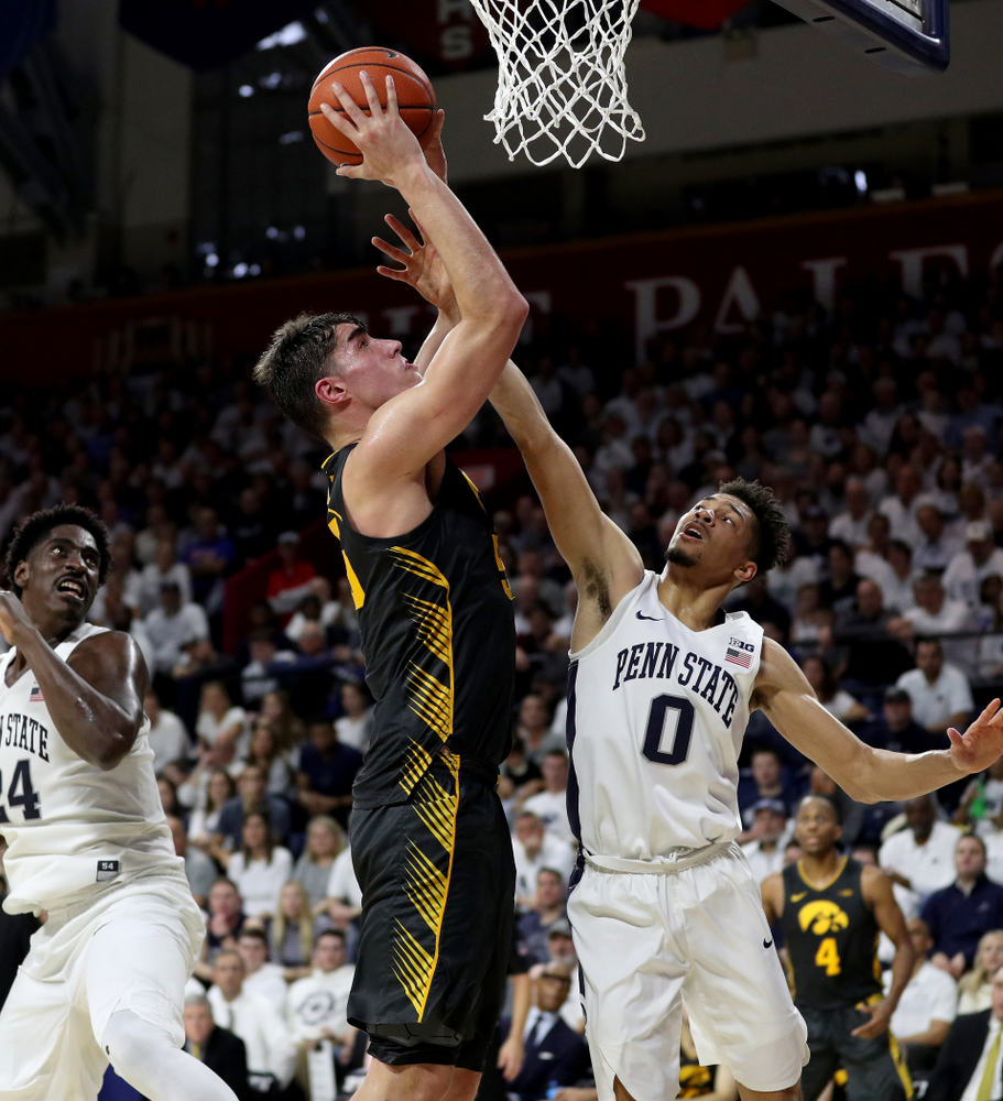 Iowa Hawkeyes forward Luka Garza (55) goes to the hoop against Penn State Saturday, January 4, 2020 at the Palestra in Philadelphia. (Brian Ray/hawkeyesports.com)