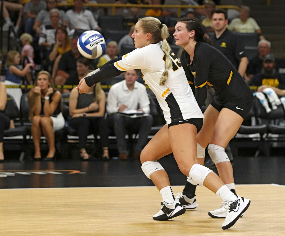 Iowa's Maddie Slagle (15) gets a dig as Halle Johnston (4) looks on during their Big Ten/Pac-12 Challenge match at Carver-Hawkeye Arena in Iowa City on Saturday, Sep 7, 2019. (Stephen Mally/hawkeyesports.com)