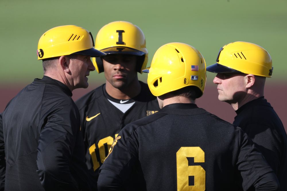 Iowa Hawkeyes Head Coach Rick Heller and assistant coach Robin Lund against California State Northridge Sunday, March 17, 2019 at Duane Banks Field. (Brian Ray/hawkeyesports.com)