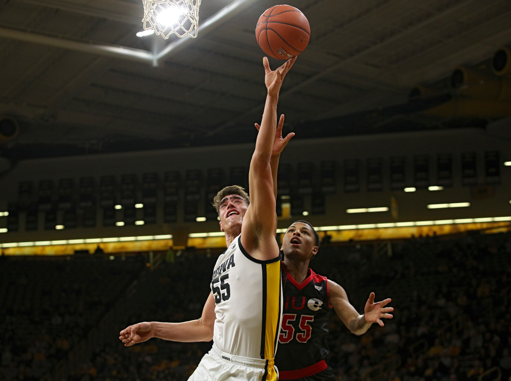 Iowa Hawkeyes center Luka Garza (55) puts up a shot during the first half of their game at Carver-Hawkeye Arena in Iowa City on Friday, Nov 8, 2019. (Stephen Mally/hawkeyesports.com)