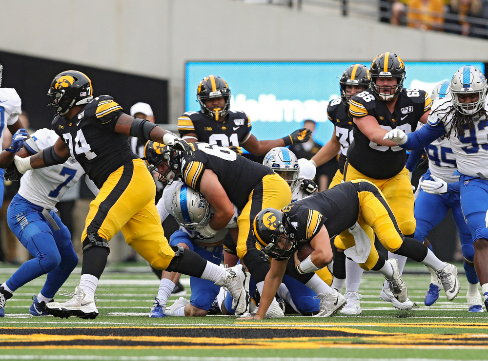 Iowa Hawkeyes quarterback Nate Stanley (4) runs for a first down during the first quarter of their game at Kinnick Stadium in Iowa City on Saturday, Sep 28, 2019. (Stephen Mally/hawkeyesports.com)