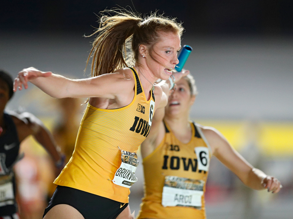 Iowa's Mariel Bruxvoort (from left) takes the baton from Taylor Arco as they run the women's 1600 meter relay event during the Larry Wieczorek Invitational at the Recreation Building in Iowa City on Saturday, January 18, 2020. (Stephen Mally/hawkeyesports.com)