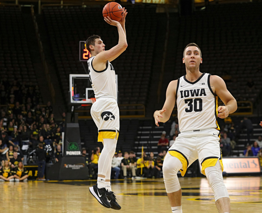 Iowa Hawkeyes guard CJ Fredrick (5) makes a 3-pointer after taking a pass from guard Connor McCaffery (30) during the second half of their exhibition game against Lindsey Wilson College at Carver-Hawkeye Arena in Iowa City on Monday, Nov 4, 2019. (Stephen Mally/hawkeyesports.com)