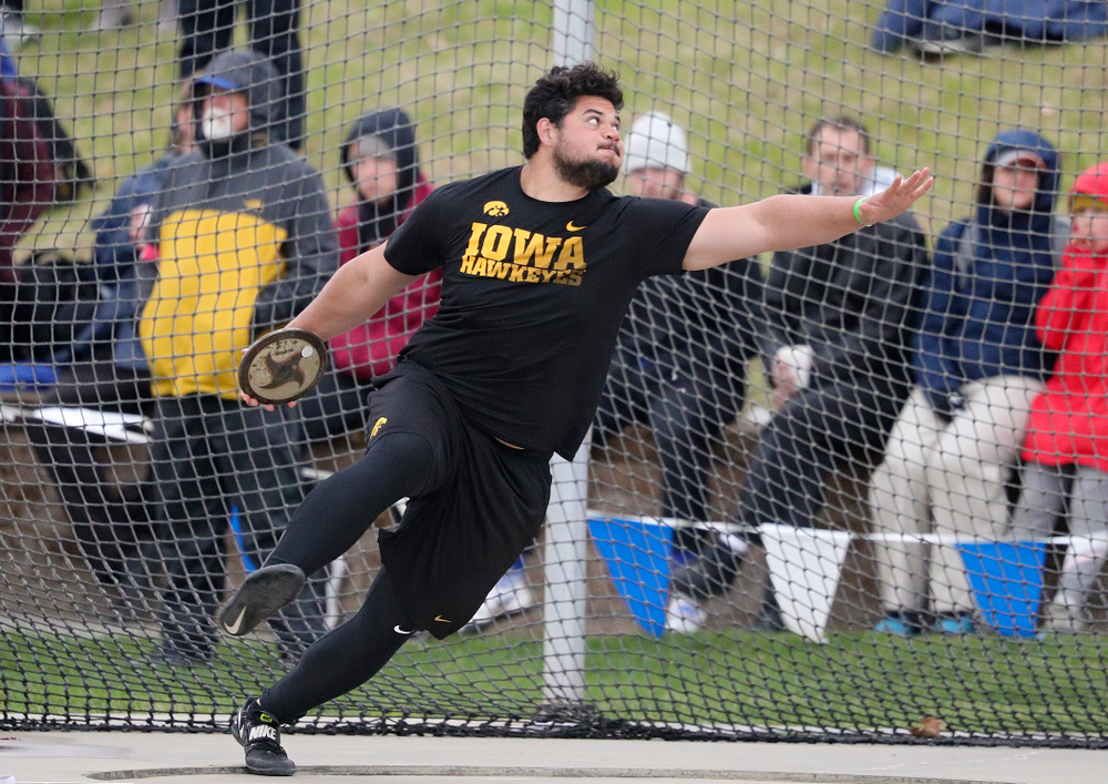 Iowa's Reno Tuufuli throws in the men's discus event during the third day of the Drake Relays at Drake Stadium in Des Moines on Saturday, Apr. 27, 2019. (Stephen Mally/hawkeyesports.com)