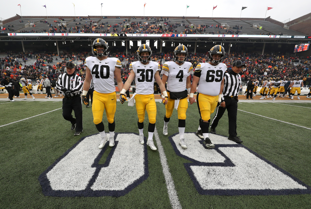 Iowa Hawkeyes captains Parker Hesse, Jake Gervase, Nate Stanley, and Keegan Render against the Illinois Fighting Illini Saturday, November 17, 2018 at Memorial Stadium in Champaign, Ill. (Brian Ray/hawkeyesports.com)