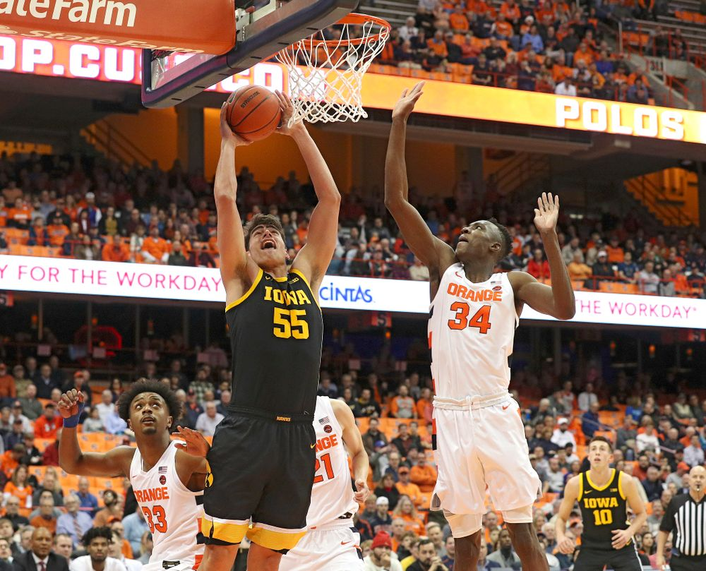 Iowa Hawkeyes center Luka Garza (55) makes a basket during the first half of their ACC/Big Ten Challenge game at the Carrier Dome in Syracuse, N.Y. on Tuesday, Dec 3, 2019. (Stephen Mally/hawkeyesports.com)