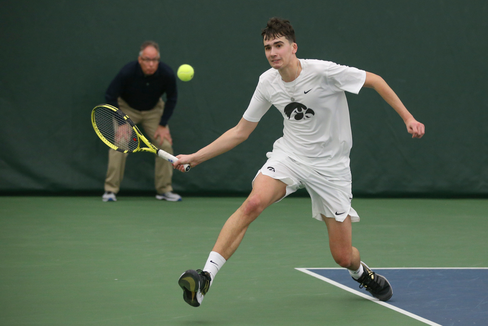 Iowa's Matt Clegg returns a hit during the Iowa men's tennis meet vs Nebraska on Sunday, March 1, 2020 at the Hawkeye Tennis and Recreation Complex. (Lily Smith/hawkeyesports.com)