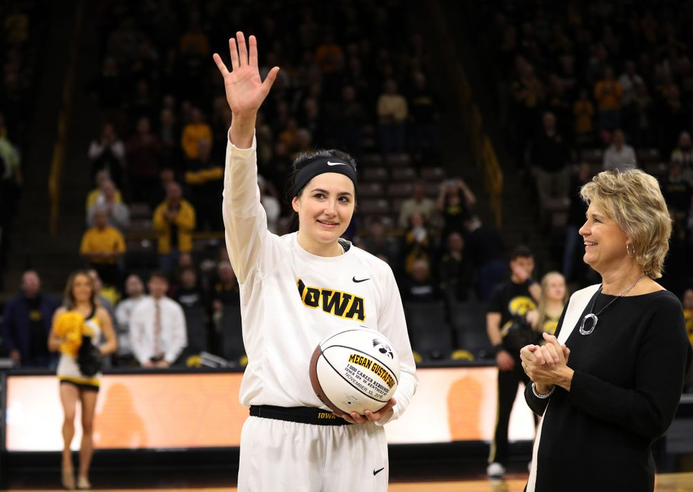 Iowa Hawkeyes forward Megan Gustafson (10) revives a ball commemorating her 1,00th career rebound from Iowa Hawkeyes head coach Lisa Bluder during their game against the IUPUI Jaguars Saturday, December 8, 2018 at Carver-Hawkeye Arena. (Brian Ray/hawkeyesports.com)
