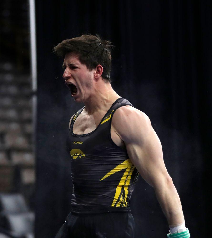 Mark Springett competes on the rings against Illinois