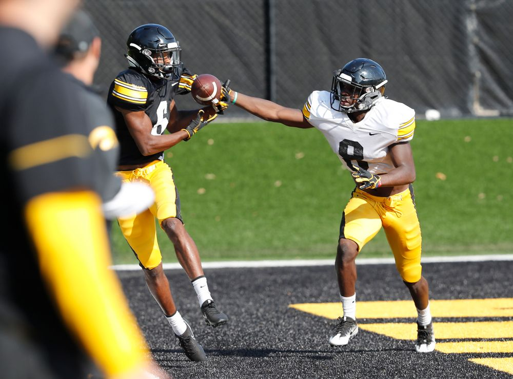 Iowa Hawkeyes wide receiver Ihmir Smith-Marsette (6) and defensive back Matt Hankins (8) during camp practice No. 17 Wednesday, August 22, 2018 at the Kenyon Football Practice Facility. (Brian Ray/hawkeyesports.com)