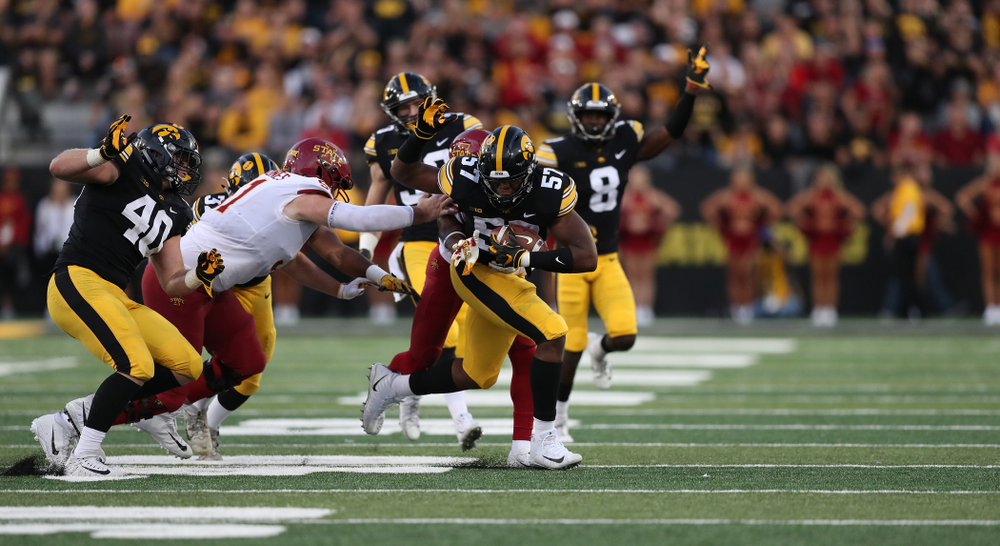Iowa Hawkeyes defensive end Chauncey Golston (57) recovers a fumble against the Iowa State Cyclones Saturday, September 8, 2018 at Kinnick Stadium. (Max Allen/hawkeyesports.com)