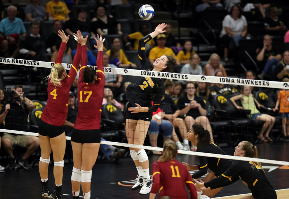 Iowa Hawkeyes setter Courtney Buzzerio (2) goes up to hit the ball against the Iowa State Cyclones Saturday, September 21, 2019 during the Iowa Corn Cy-Hawk Series Tournament at Carver-Hawkeye Arena. (Brian Ray/hawkeyesports.com)