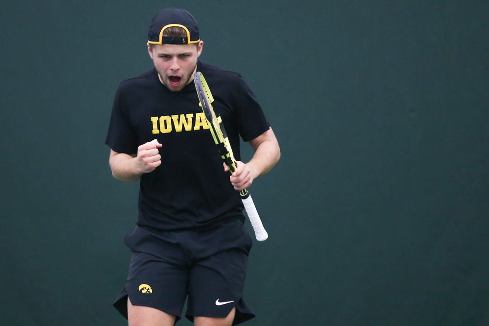 Iowa's Will Davies celebrates a point during the Iowa men's tennis meet vs VCU  on Saturday, February 29, 2020 at the Hawkeye Tennis and Recreation Complex. (Lily Smith/hawkeyesports.com)