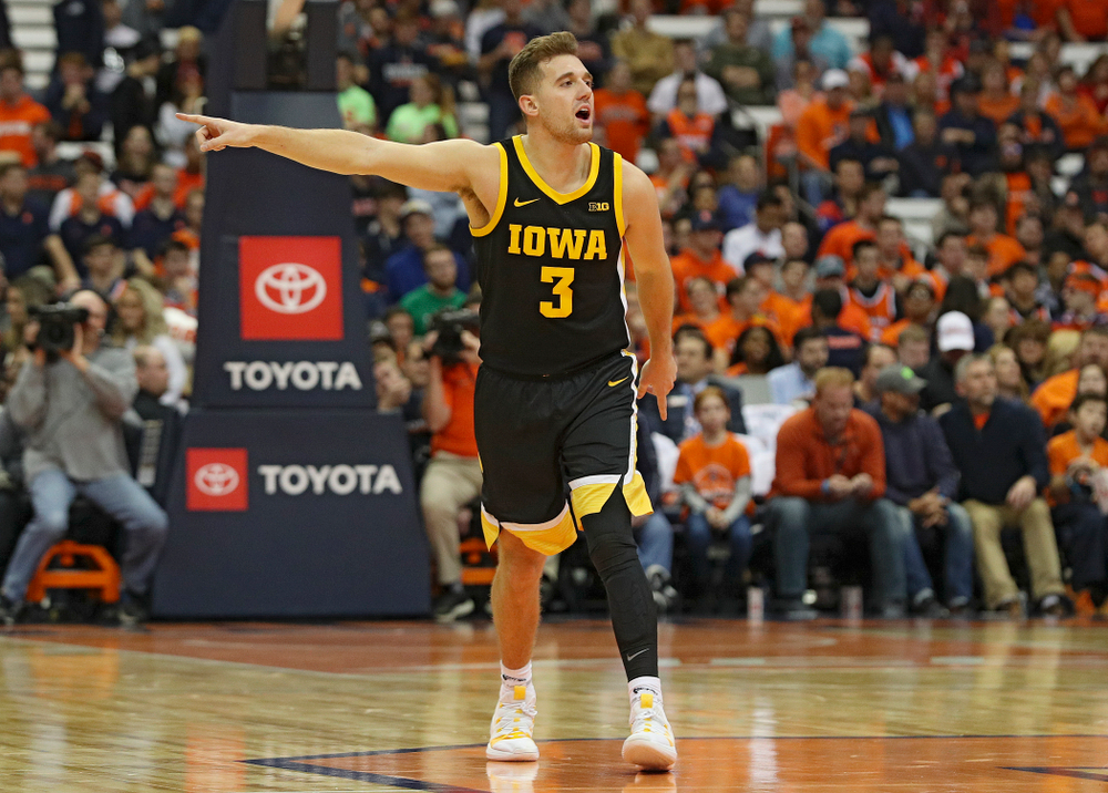 Iowa Hawkeyes guard Jordan Bohannon (3) directs his teammates during the second half of their ACC/Big Ten Challenge game at the Carrier Dome in Syracuse, N.Y. on Tuesday, Dec 3, 2019. (Stephen Mally/hawkeyesports.com)
