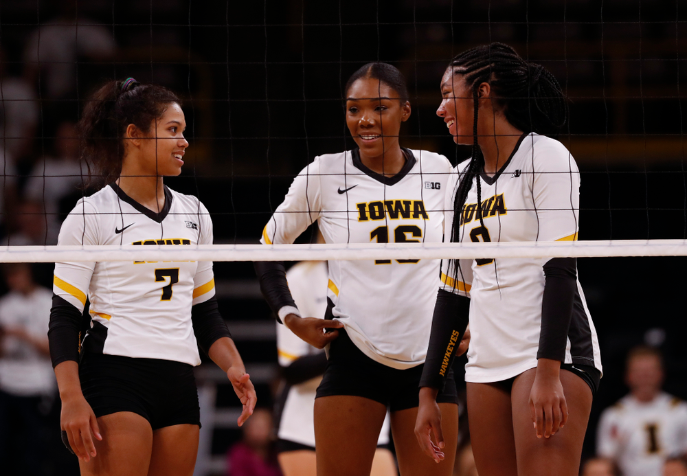 Iowa Hawkeyes setter Gabrielle Orr (7), outside hitter Taylor Louis (16), and middle blocker Amiya Jones (9) against the Michigan State Spartans Friday, September 21, 2018 at Carver-Hawkeye Arena. (Brian Ray/hawkeyesports.com)
