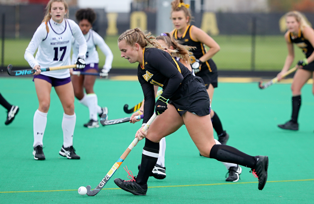Iowa's Katie Birch (11) moves with the ball during the second quarter of their game at Grant Field in Iowa City on Saturday, Oct 26, 2019. (Stephen Mally/hawkeyesports.com)