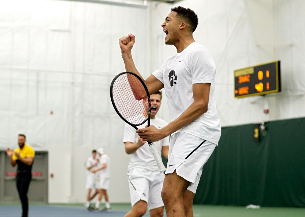 Iowa's Oliver Okonkwo celebrates a point during his doubles match at the Hawkeye Tennis and Recreation Complex in Iowa City on Sunday, February 16, 2020. (Stephen Mally/hawkeyesports.com)