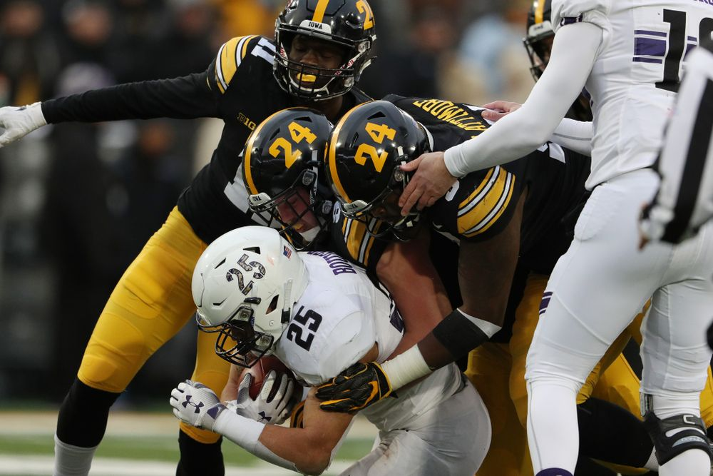 Iowa Hawkeyes defensive lineman Brady Reiff (91) and defensive lineman Cedrick Lattimore (95) against the Northwestern Wildcats Saturday, November 10, 2018 at Kinnick Stadium. (Brian Ray/hawkeyesports.com)