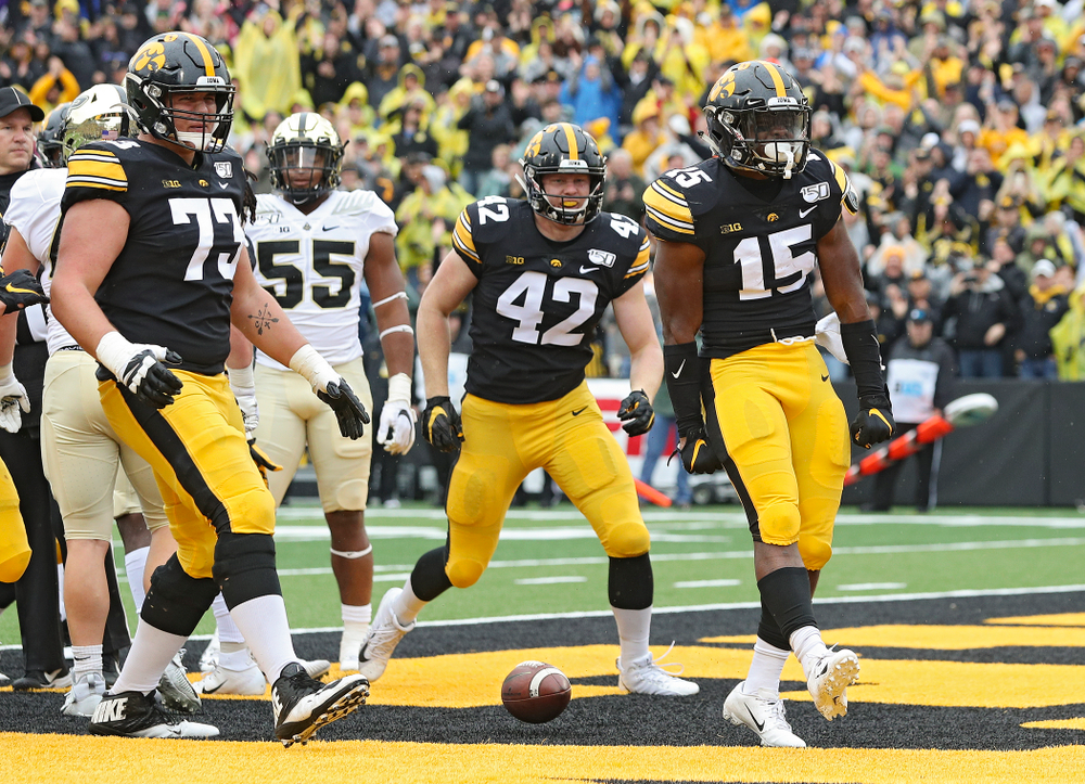 Iowa Hawkeyes running back Tyler Goodson (15) celebrates after scoring a touchdown during the third quarter of their game at Kinnick Stadium in Iowa City on Saturday, Oct 19, 2019. (Stephen Mally/hawkeyesports.com)