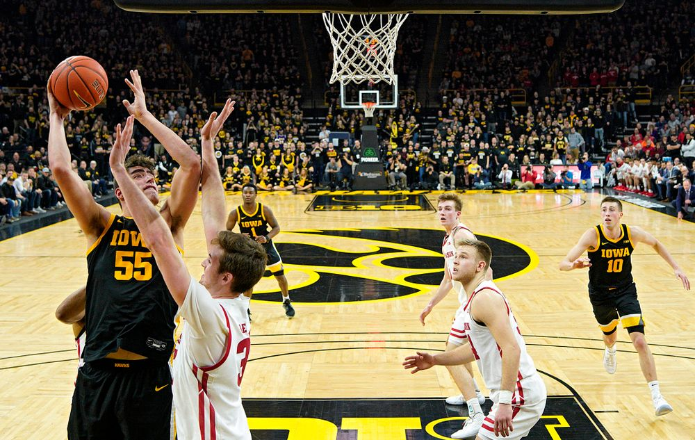 Iowa Hawkeyes center Luka Garza (55) puts up a shot during the second half of their game at Carver-Hawkeye Arena in Iowa City on Monday, January 27, 2020. (Stephen Mally/hawkeyesports.com)