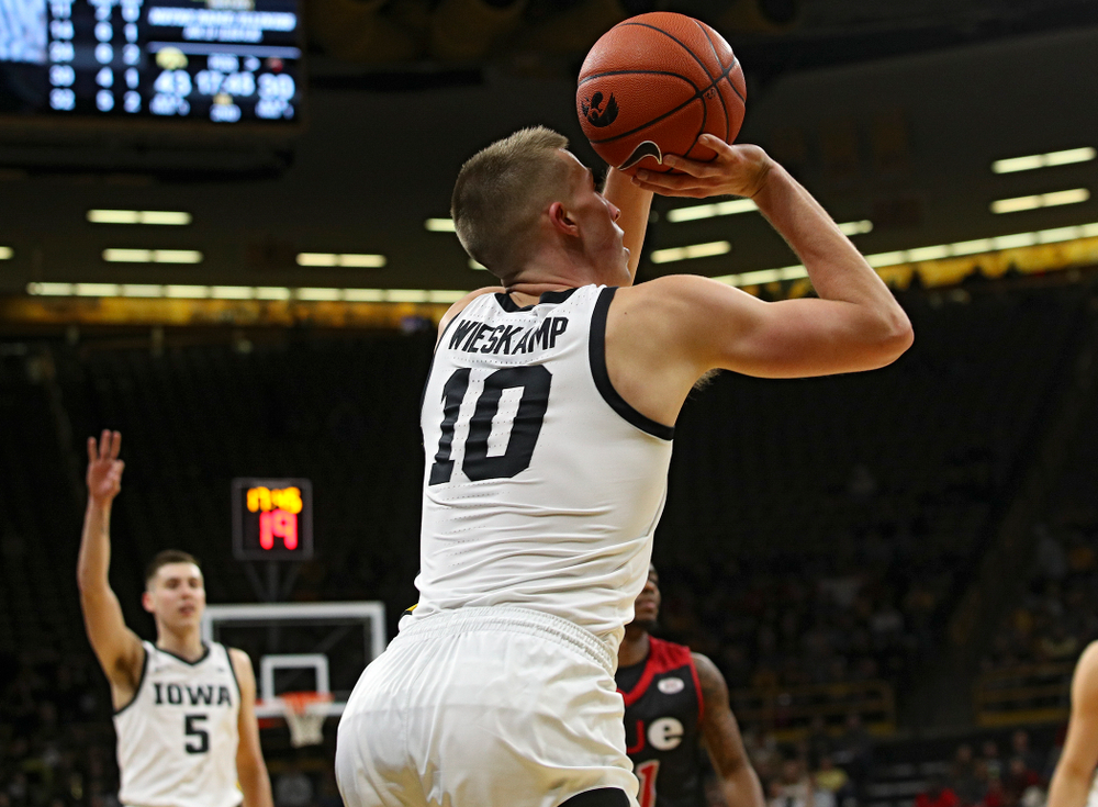 Iowa Hawkeyes guard Joe Wieskamp (10) makes a 3-pointer as guard CJ Fredrick (5) holds up three fingers as he starts to celebrate during the second half of their game at Carver-Hawkeye Arena in Iowa City on Friday, Nov 8, 2019. (Stephen Mally/hawkeyesports.com)
