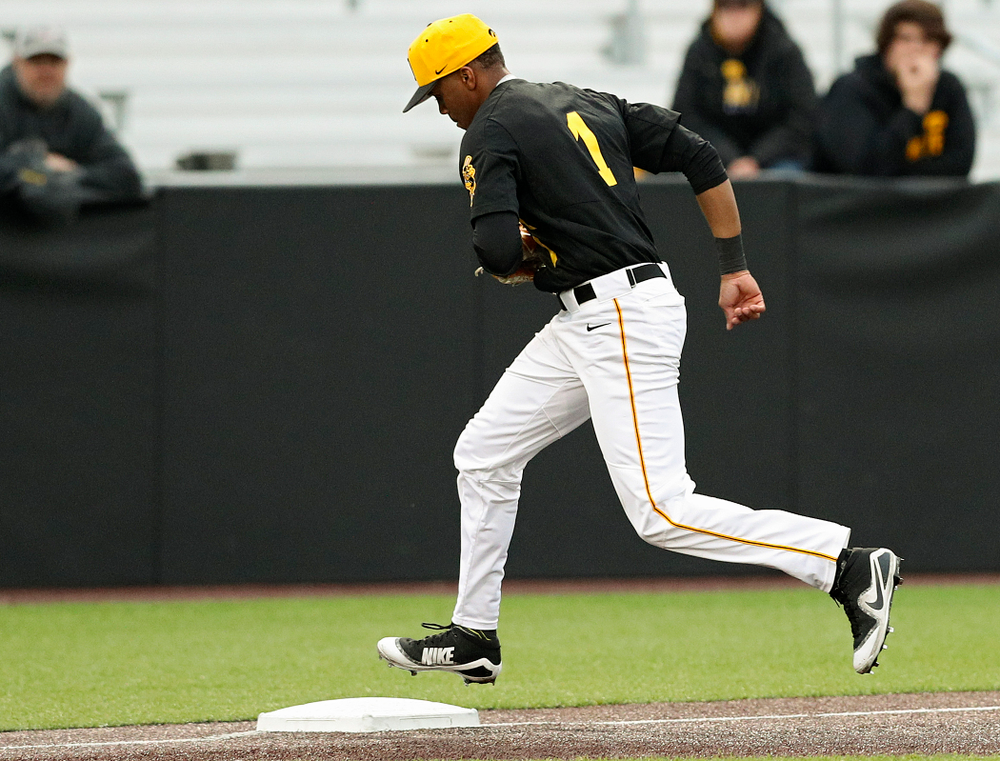 Iowa Hawkeyes third baseman Lorenzo Elion (1) steps on third base after fielding a ground ball to get the third out during the third inning of their game against Western Illinois at Duane Banks Field in Iowa City on Wednesday, May. 1, 2019. (Stephen Mally/hawkeyesports.com)