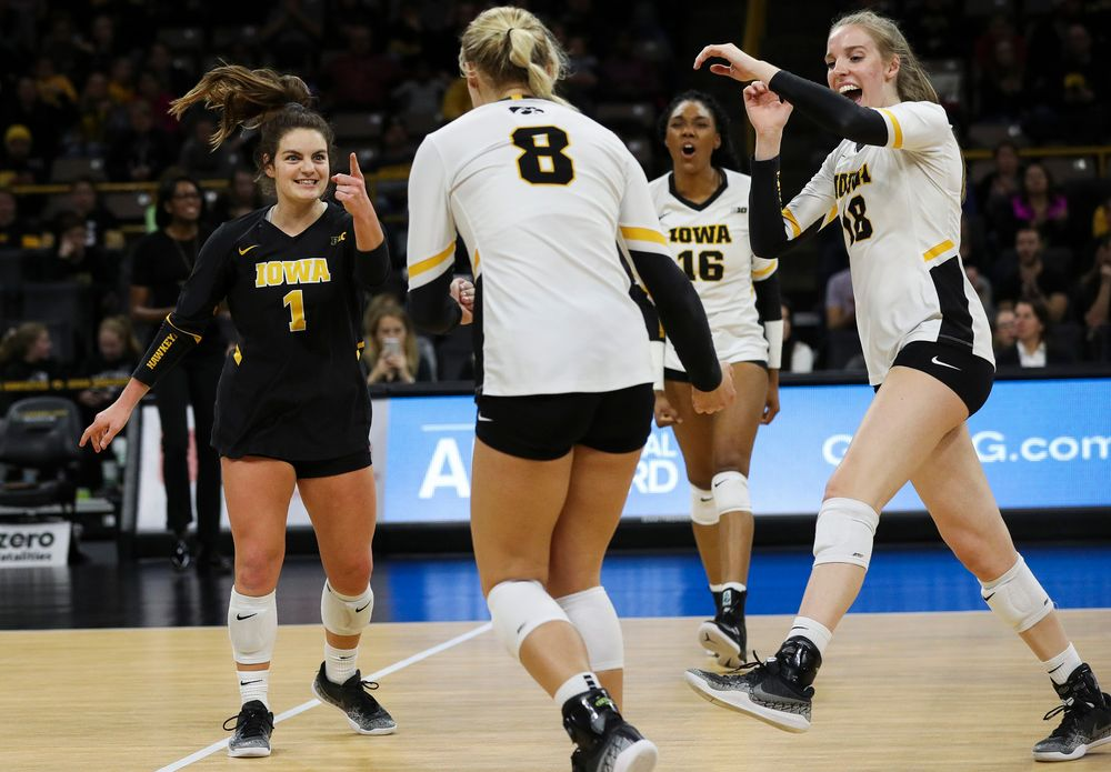 Iowa Hawkeyes defensive specialist Molly Kelly (1) and Iowa Hawkeyes middle blocker Hannah Clayton (18) celebrate after winning a point during a match against Maryland at Carver-Hawkeye Arena on November 23, 2018. (Tork Mason/hawkeyesports.com)