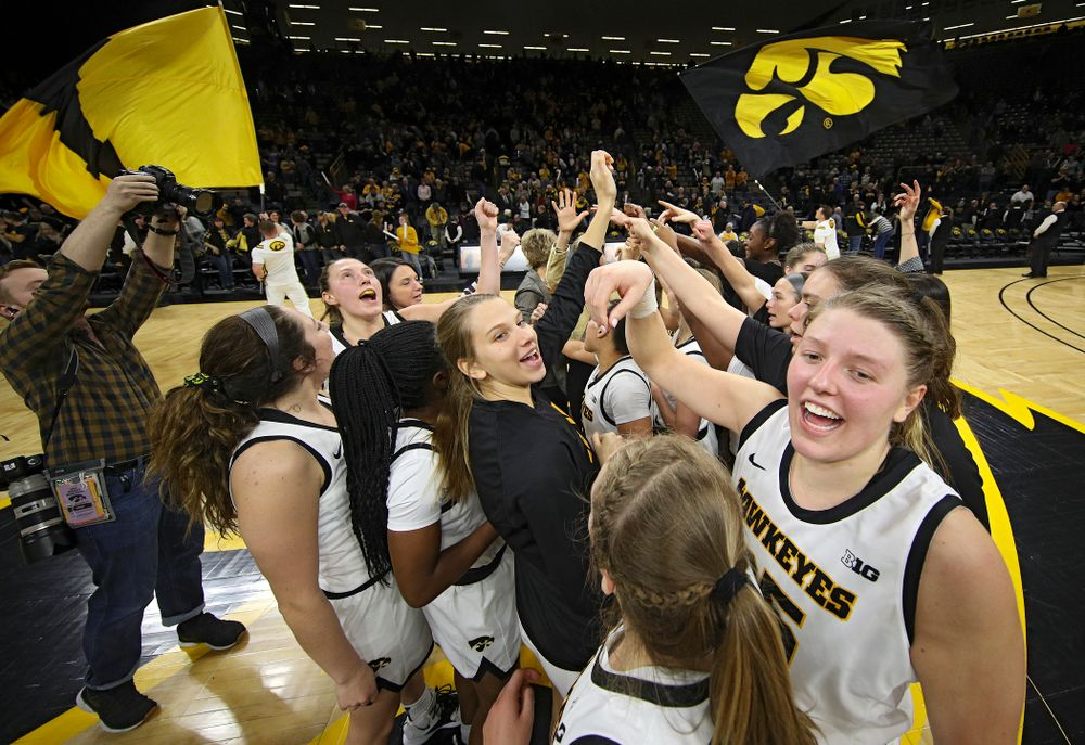 The Iowa Hawkeyes huddle after winning their game at Carver-Hawkeye Arena in Iowa City on Thursday, February 6, 2020. (Stephen Mally/hawkeyesports.com)