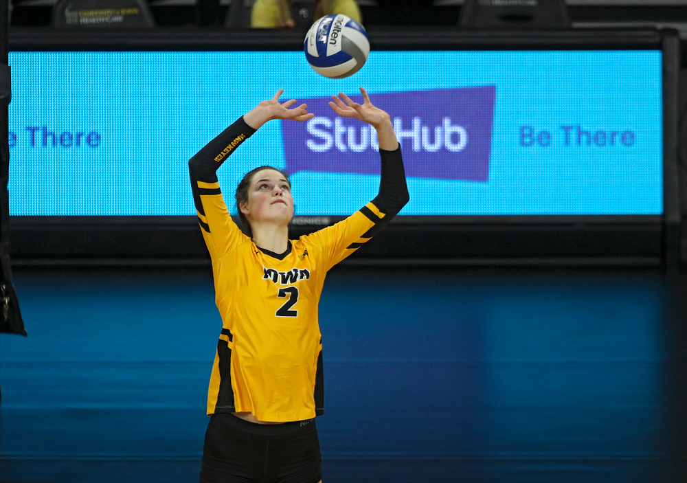Iowa's Courtney Buzzerio (2) sets the ball during the second set of their match against Illinois at Carver-Hawkeye Arena in Iowa City on Wednesday, Nov 6, 2019. (Stephen Mally/hawkeyesports.com)