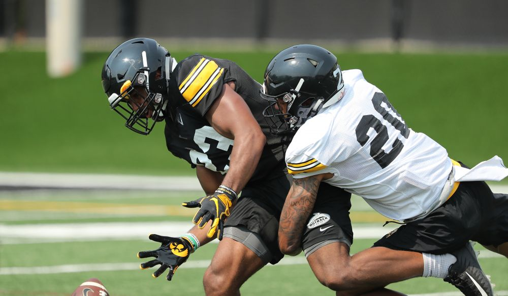 Iowa Hawkeyes wide receiver Dominique Dafney (23) and defensive back Julius Brents (20)