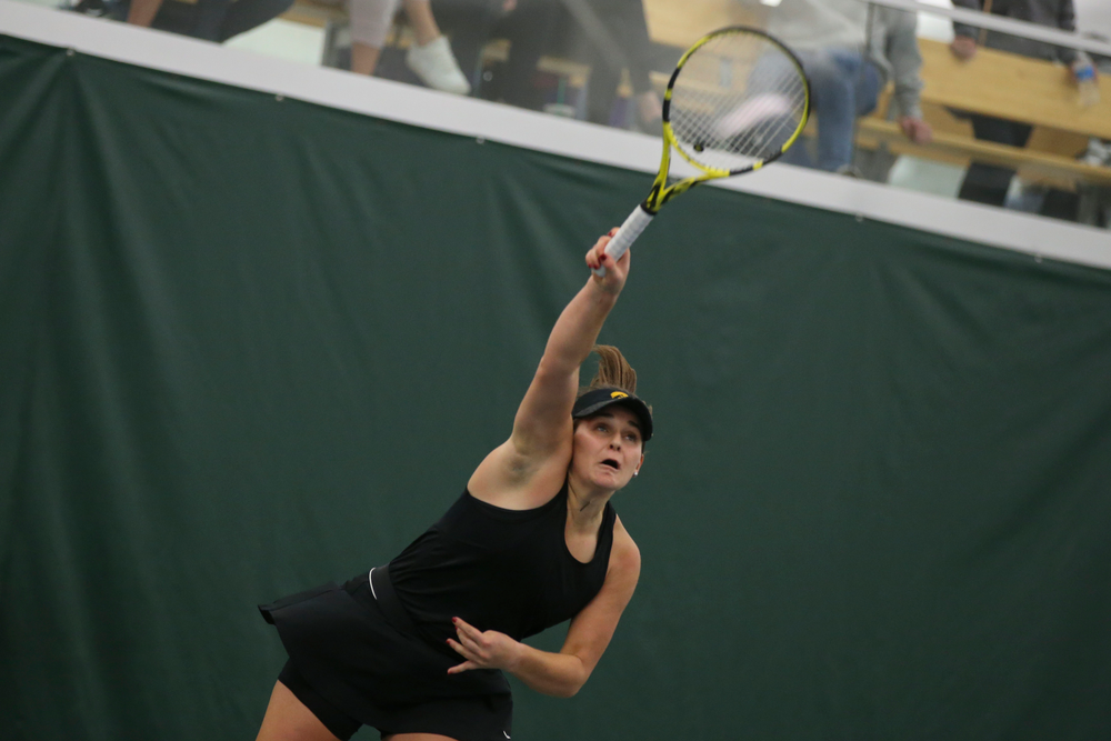 Iowa's Danielle Bauers serves a ball during the Iowa women's tennis meet vs UNI  on Saturday, February 29, 2020 at the Hawkeye Tennis and Recreation Complex. (Lily Smith/hawkeyesports.com)