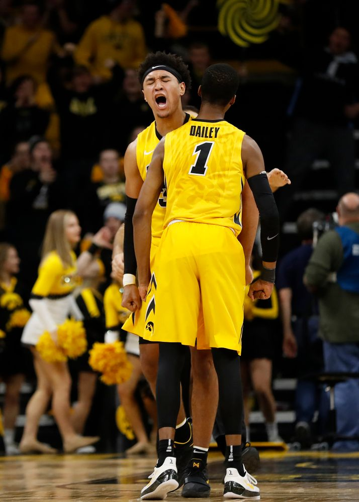 Iowa Hawkeyes guard Maishe Dailey (1) and forward Cordell Pemsl (35)