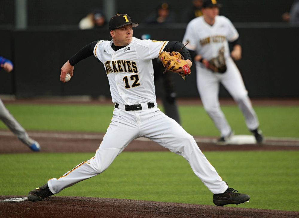 Iowa pitcher Drew Irvine (12) delivers to the plate during the sixth inning of their college baseball game at Duane Banks Field in Iowa City on Wednesday, March 11, 2020. (Stephen Mally/hawkeyesports.com)