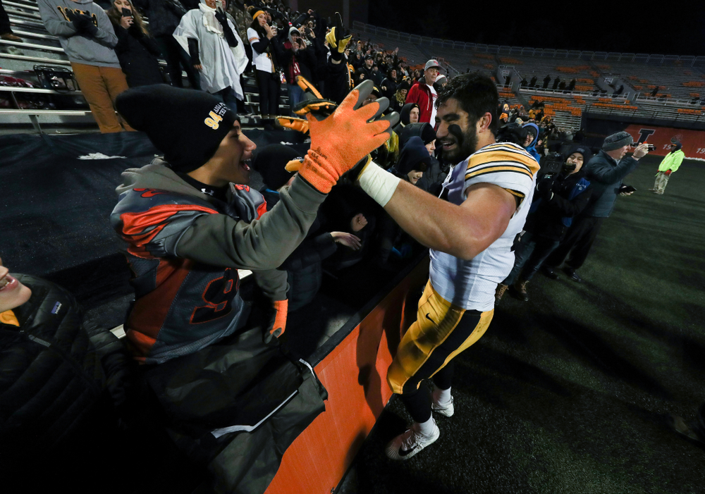 Iowa Hawkeyes defensive end A.J. Epenesa (94) hugs his little brother following their game against the Illinois Fighting Illini Saturday, November 17, 2018 at Memorial Stadium in Champaign, Ill. (Brian Ray/hawkeyesports.com)