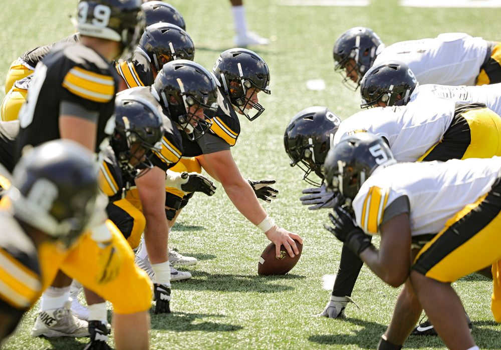 Iowa Hawkeyes offensive lineman Tyler Linderbaum (65) prepares to snap the ball during Fall Camp Practice #5 at the Hansen Football Performance Center in Iowa City on Tuesday, Aug 6, 2019. (Stephen Mally/hawkeyesports.com)